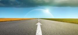 Empty asphalt road towards cloud and signs symbolizing success a