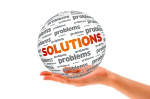 Hand holding a Solutions 3D Sphere