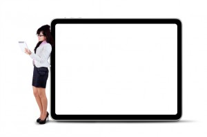 Businesswoman using digital tablet with copyspace